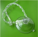Suction cups with clear, adjustable, re-useable cable ties.